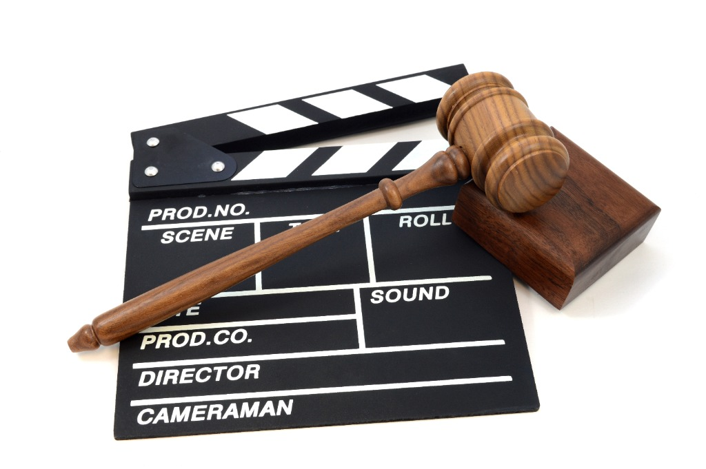 judge gavel on top of a director's clapperboard
