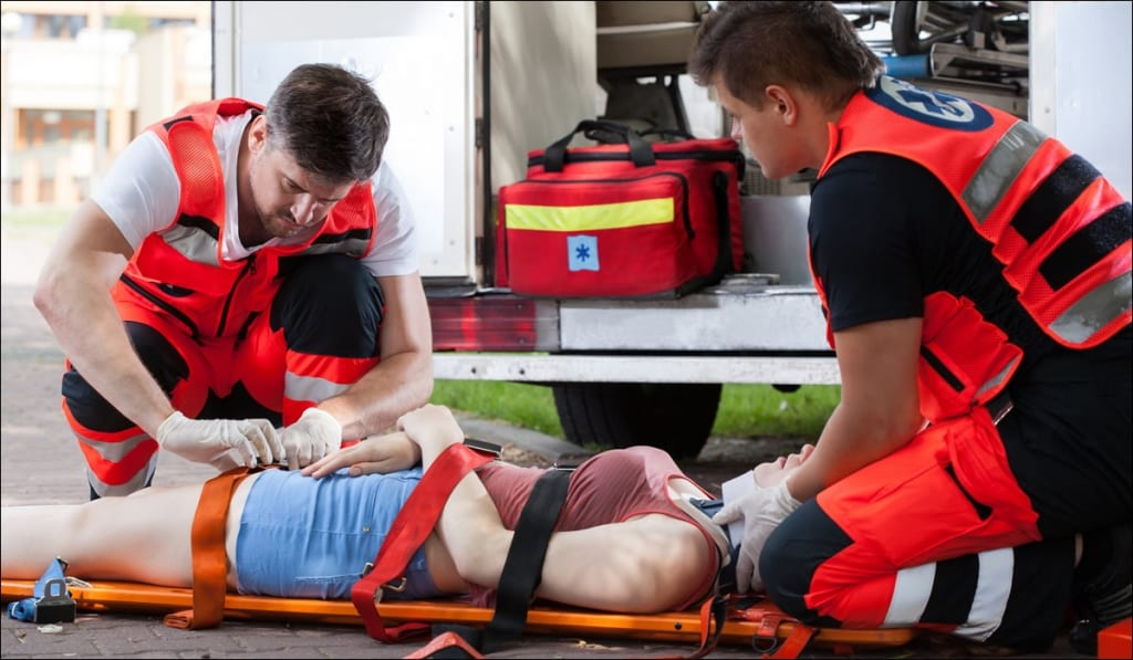 woman put on stretcher by emts after personal injury
