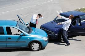 two men angry at the scene of a car crash