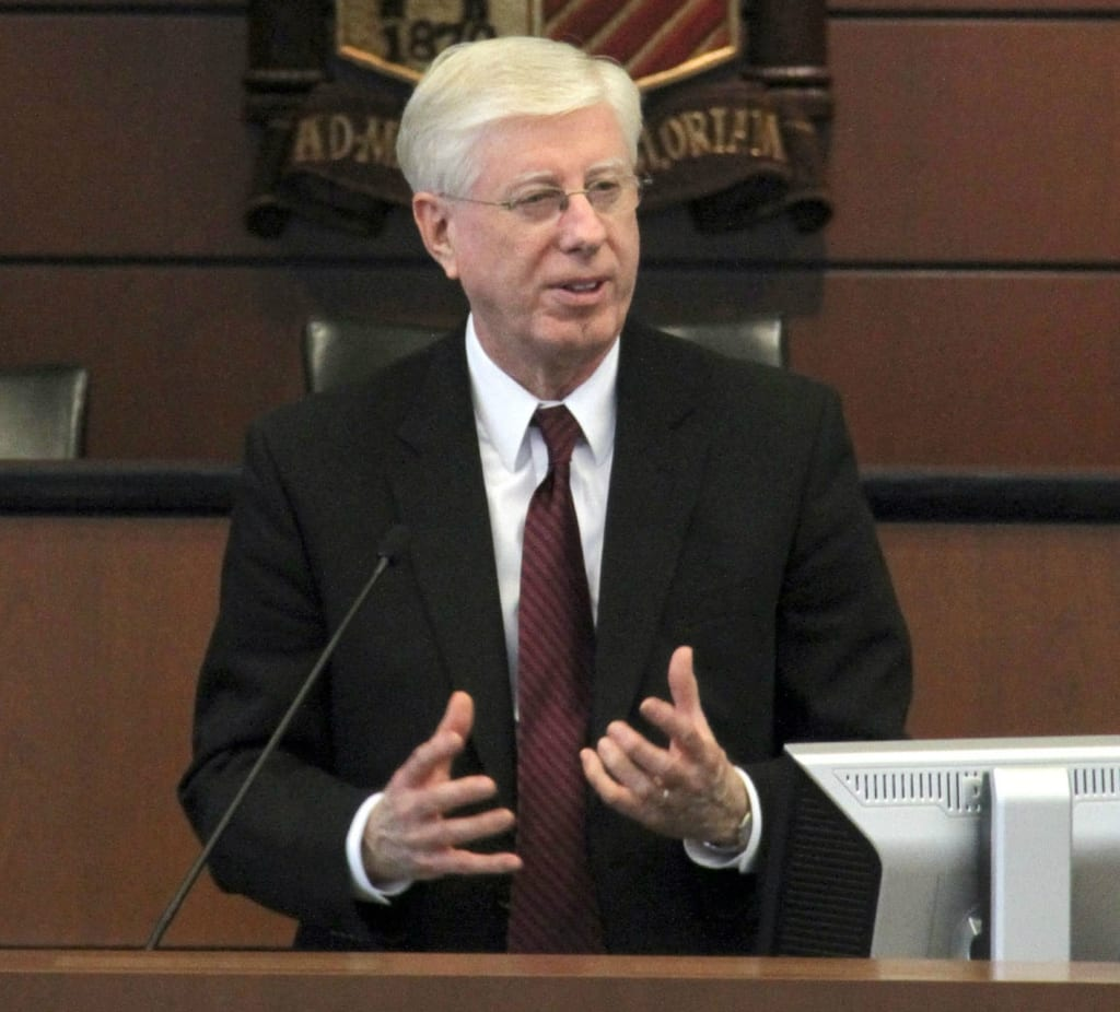 Attorney General Tom J Miller speaking at a hearing