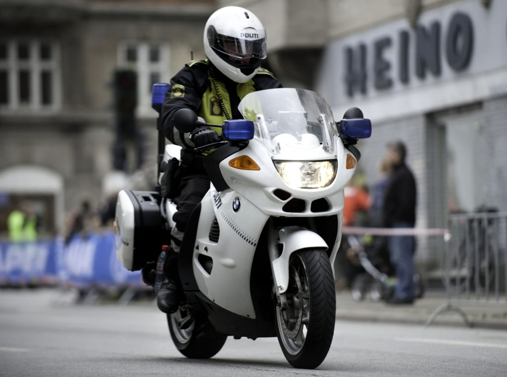 Danish police safely driving a motorcycle