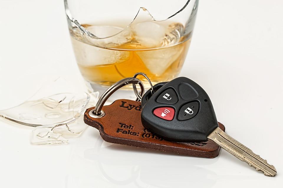 Glass of whiskey next to car keys