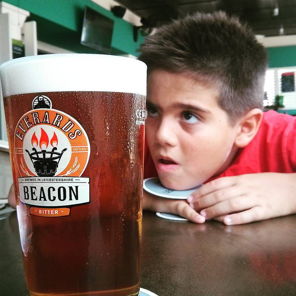 kid looking at beer glass
